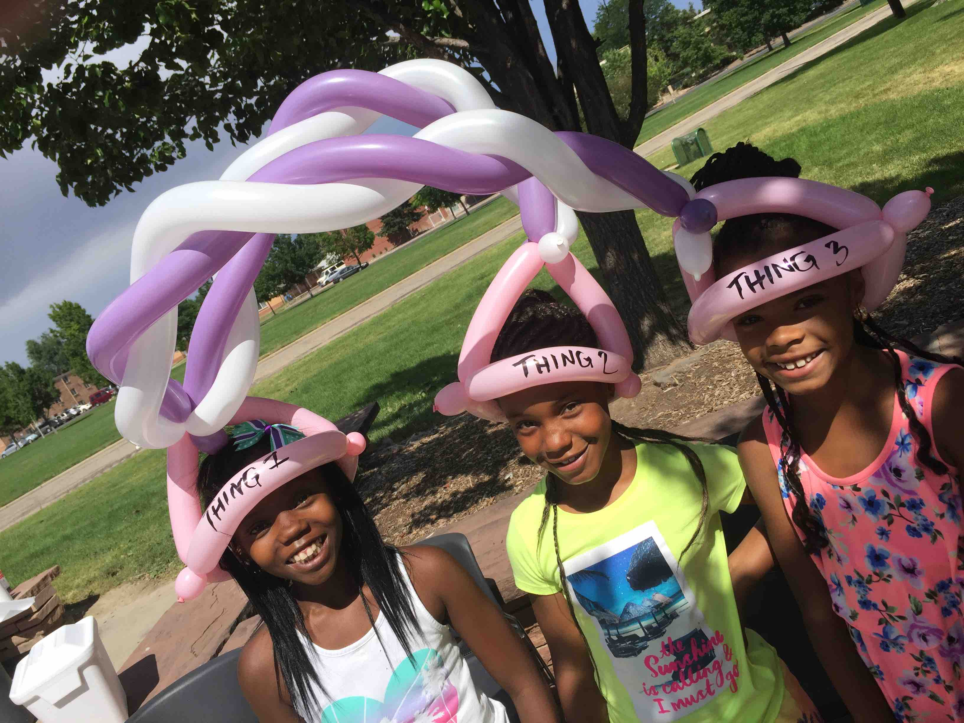 3 girls with shared balloon hat