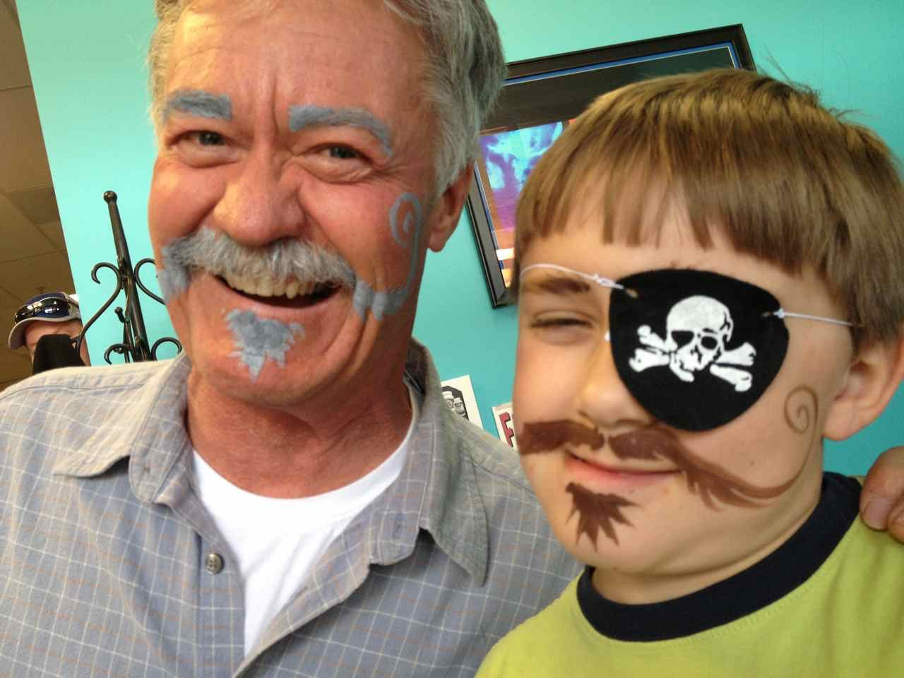 Grandpa and grandkid with pirate beards