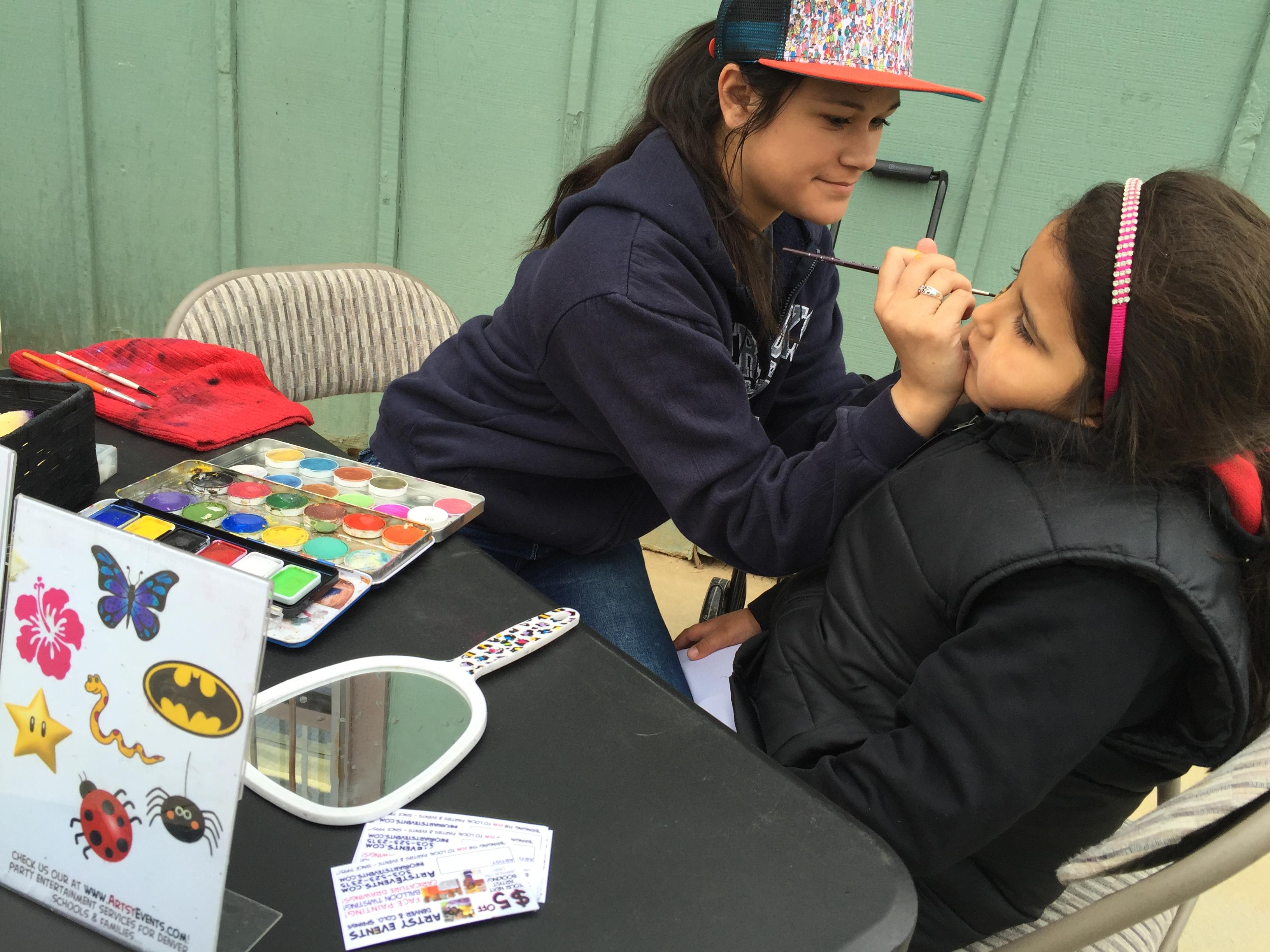 Faith face painting at a softball event